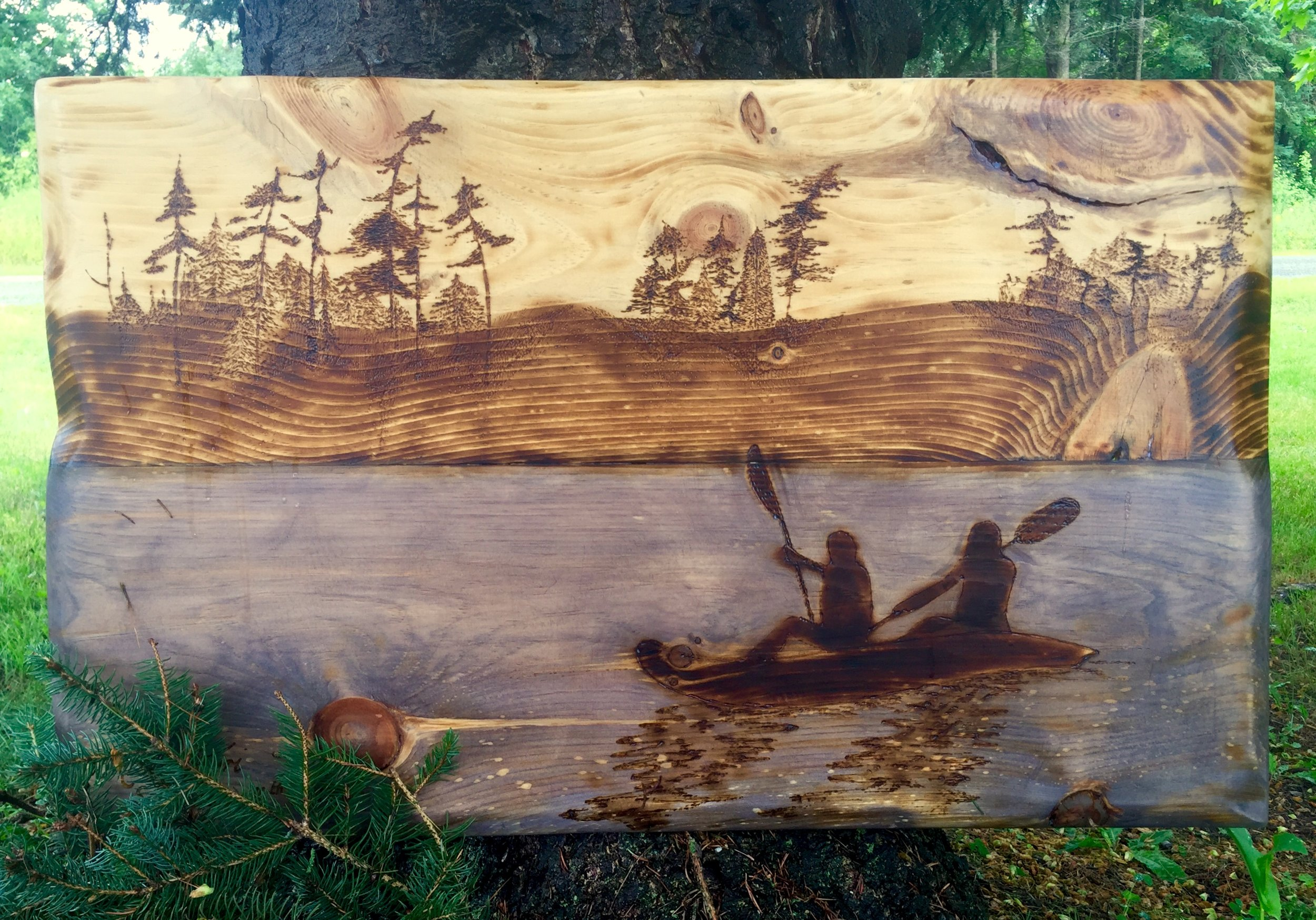woodburned canoe scene.jpg