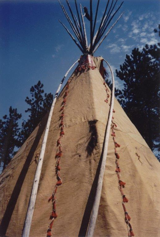 Tipi back - poles open flaps to allow smoke through