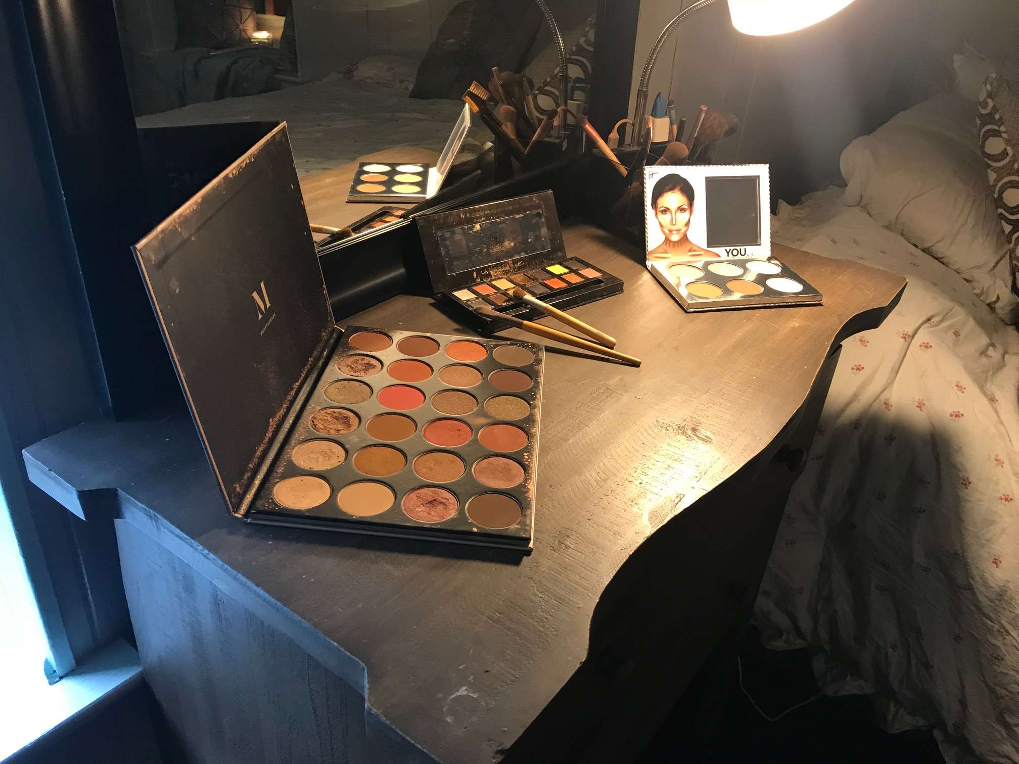 A forgotten mirror hidden in the corner and a lamp stored in the garage was just what this table needed in order to provide the perfect makeup center!