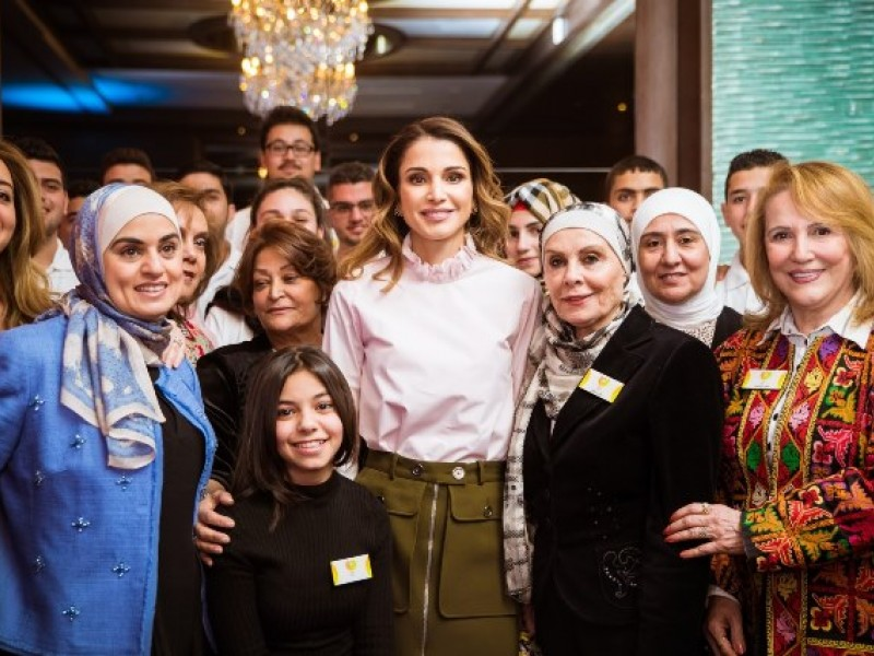 Queen Rania (center) surrounded by Jordanian women. Photo is from Queen Rania Official Website (https://www.queenrania.jo/en).