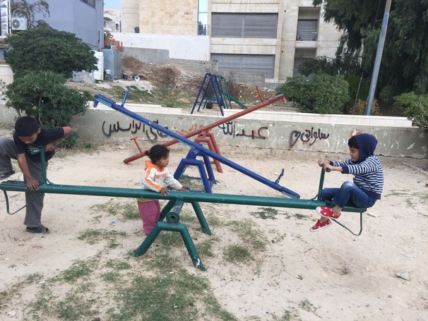 Local Jordanian children and my son playing in a playground.