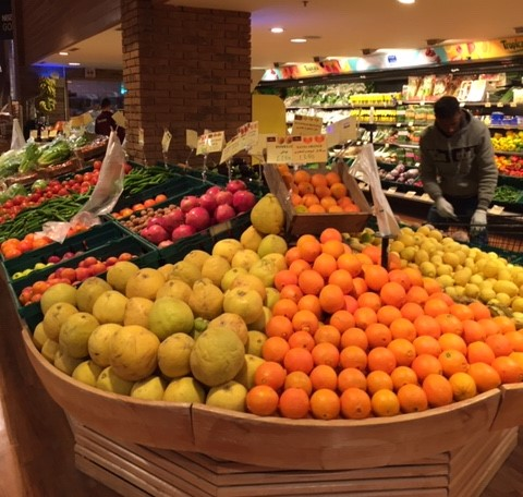 A local supermarket selling a variety of fresh fruits and vegetables brought from Jordan Valley, Turkey, Egypt, and Syria.