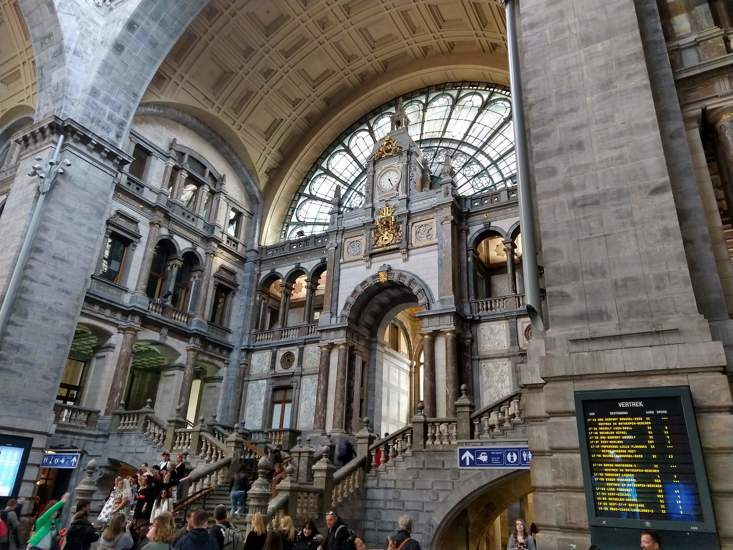 There's some sort of nostalgic romance in train stations. Antwerp's is gorgeous and worth dropping in just to take pictures (as the hen party on the stairs was doing).