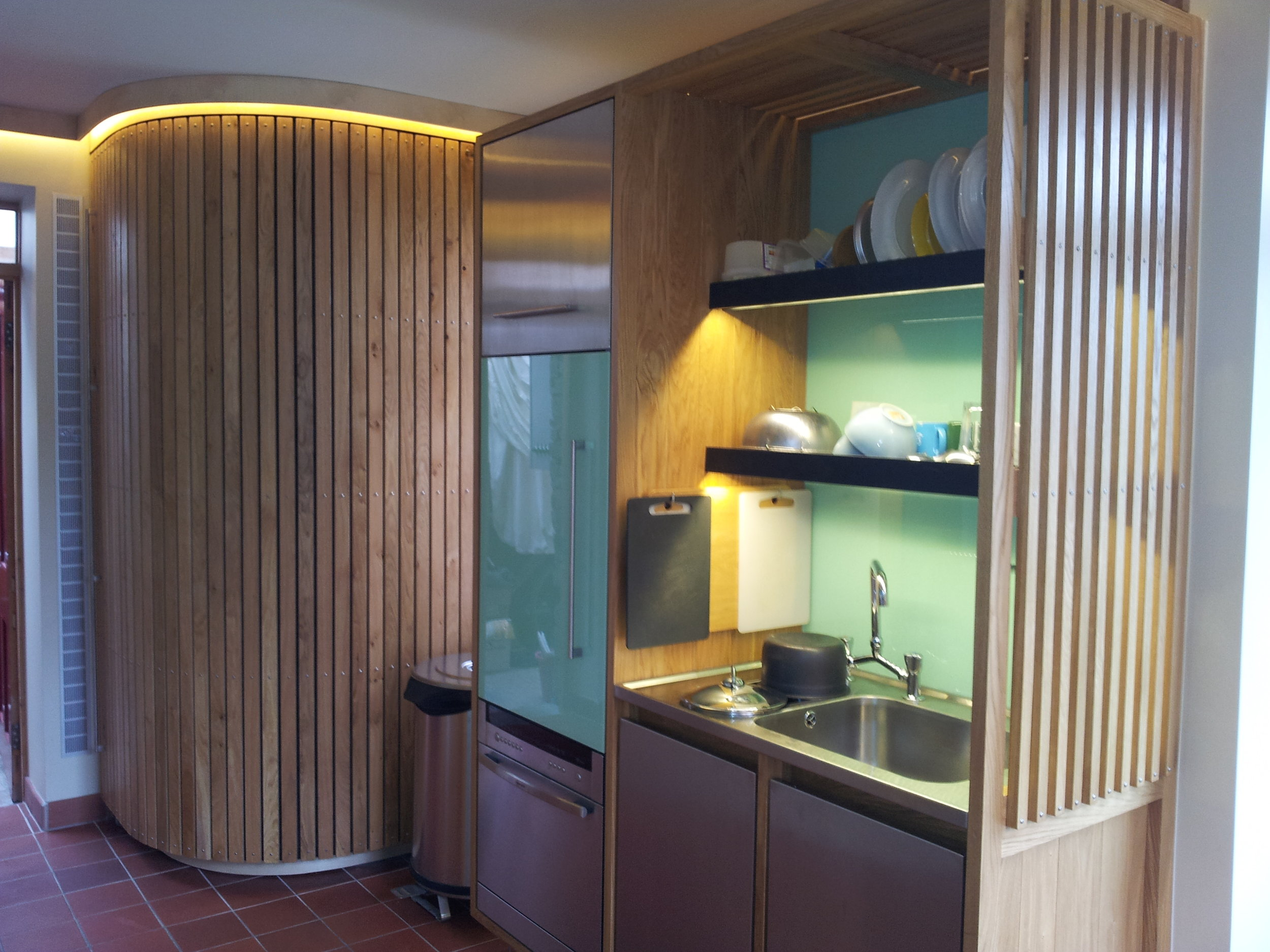 Designer Kitchen curvy cupboard and slate shelves.jpg