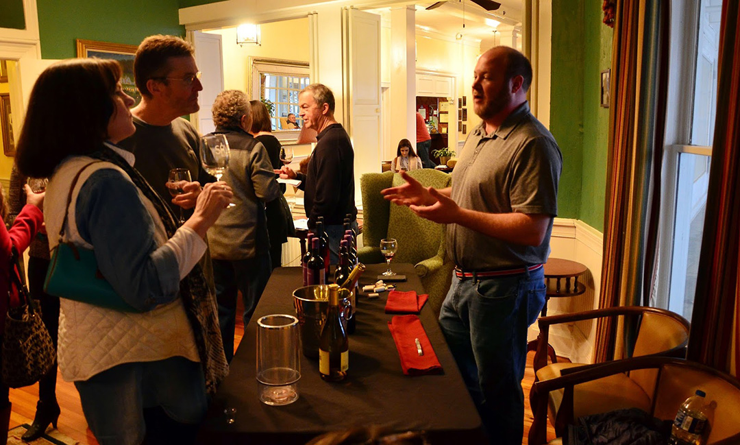 A couple tries the 2015 Klinker Brick Tranzind from Fine Wines Trading Company.