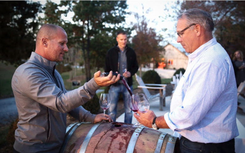 Joey Medaloni, left, pours wine straight from the barrel to one of the attendees at the Meet & Greet event on November 5 at Medaloni Cellars.