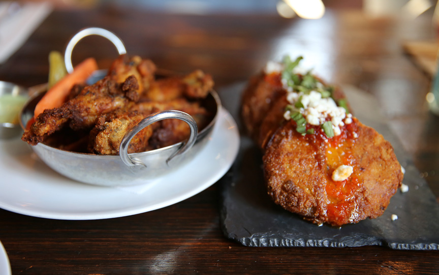 APPETIZERS: Smoked, crispy Texas Pete dry rubbed wings and fried green tomatoes, goat cheese, pepper jelly and basil