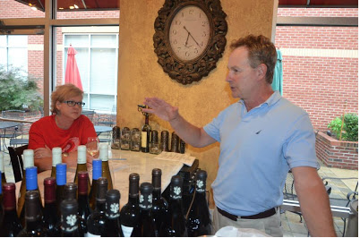 Uncorked's Owner Tony Fox gives details about the French wines being poured that evening.   Photo by Dathan Kazsuk