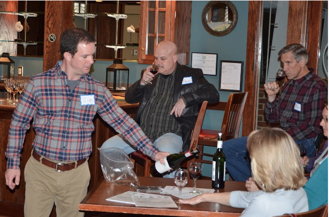 Jim Soffe with Fine Wine Trading Company pours wines from South African during the FRW&BC's March event