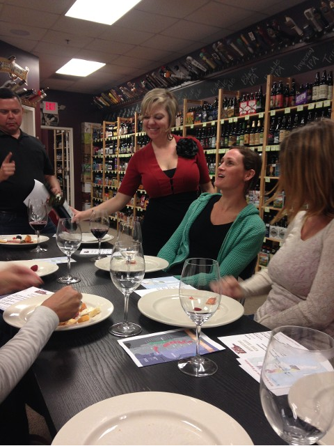 Wine 101-Wake Forest's wine manager Sara Doom has some fun with the guests.