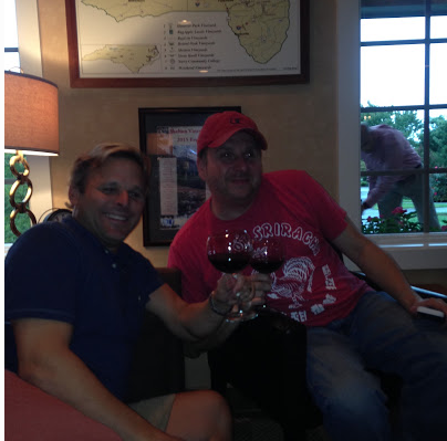 - Chris Morton with The Morton Group and Dathan Kazsuk with Triangle Around Town toasting after the interview