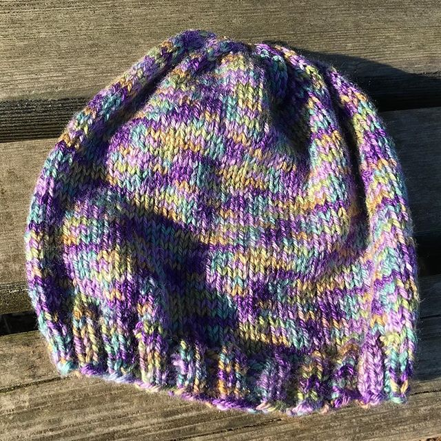 This hat is knit in multicolor acrylic by @wyldkit.  Hat is available in exchange for a donation of $10 or more to @packyourbackmi, which helps kids in #Flint & beyond. Donation link: https://secure.givelively.org/donate/pack-your-back/knitters-for-flint  Email knittersforflint@Gmail.com to check availability.  #knittersforflint #knitthewave #knittersofinstagram