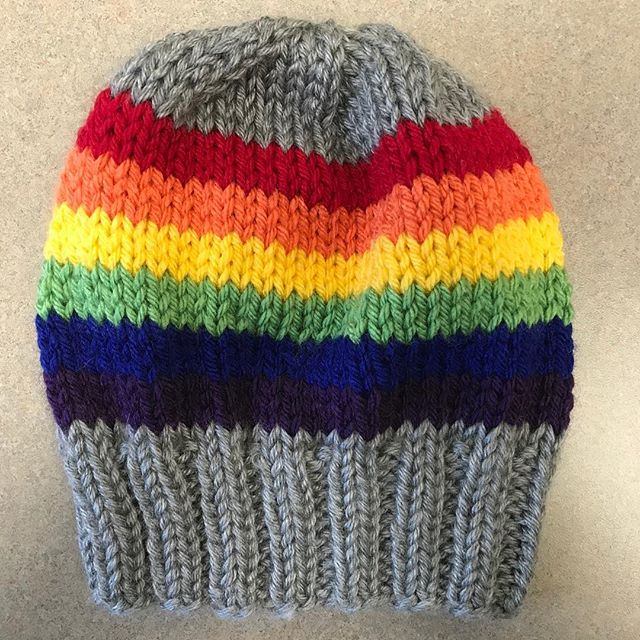 #Rainbow hat knit in acrylic by @wyldkit.  Hat is available in exchange for a donation of $30 or more to @packyourback, which helps kids in #Flint. Donation link: secure.givelively.org/donate/pack-yo…  Email knittersforflint@gmail.com to check availability.  #knittersforflint #KnitTheWave #knittersofinstagram