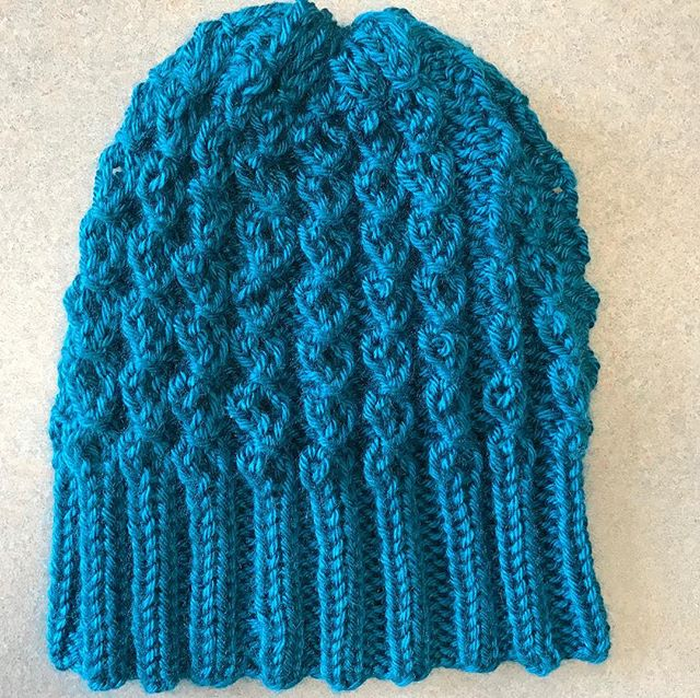 Our popular #BlueWave hat knit in acrylic by @wyldkit.  Available in exchange for a donation of $15 or more to @packyourback, which helps kids in #Flint.  Donation link: https://secure.givelively.org/donate/pack-your-back/knitters-for-flint  #knittersforflint #KnitTheWave #knitting  Hurry! These go fast! Reply to claim yours!