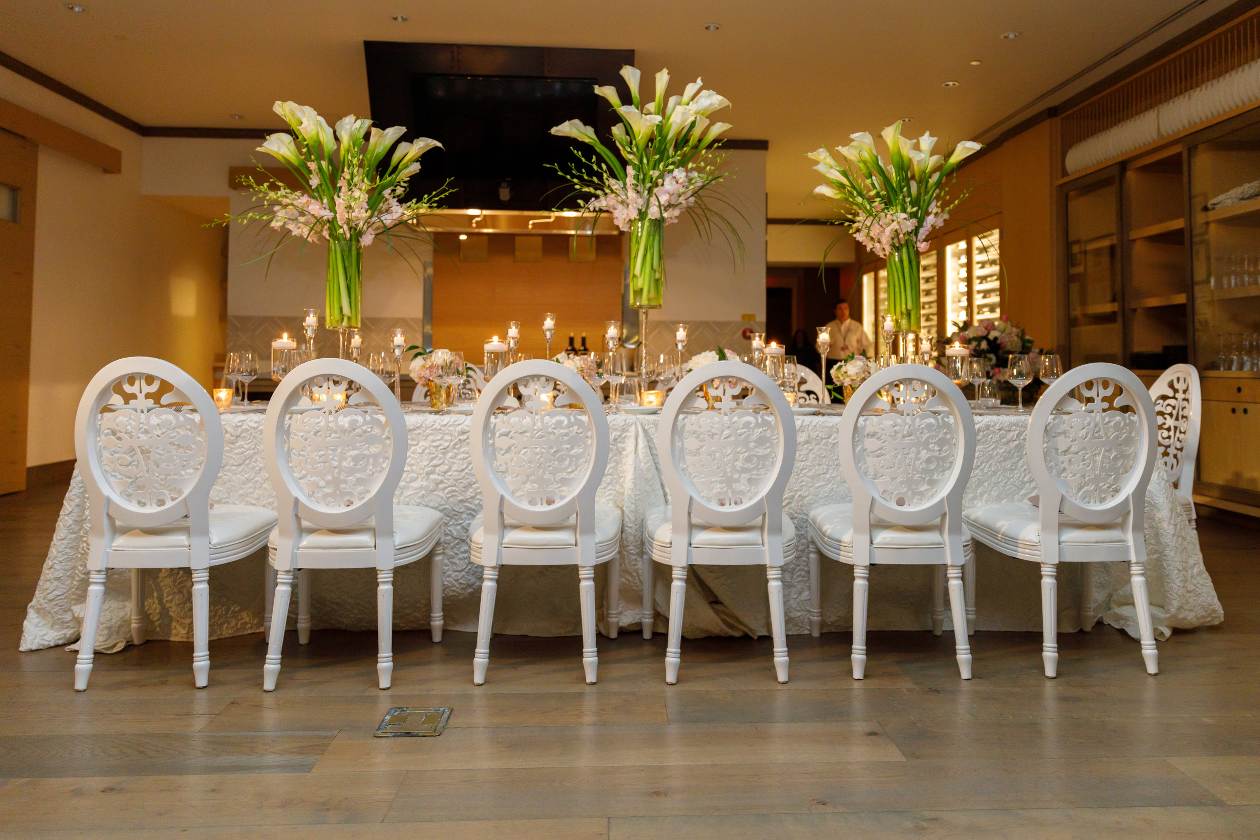 Elegant white, silver and blush table with candlelight, calla lilies and tulips for proposal