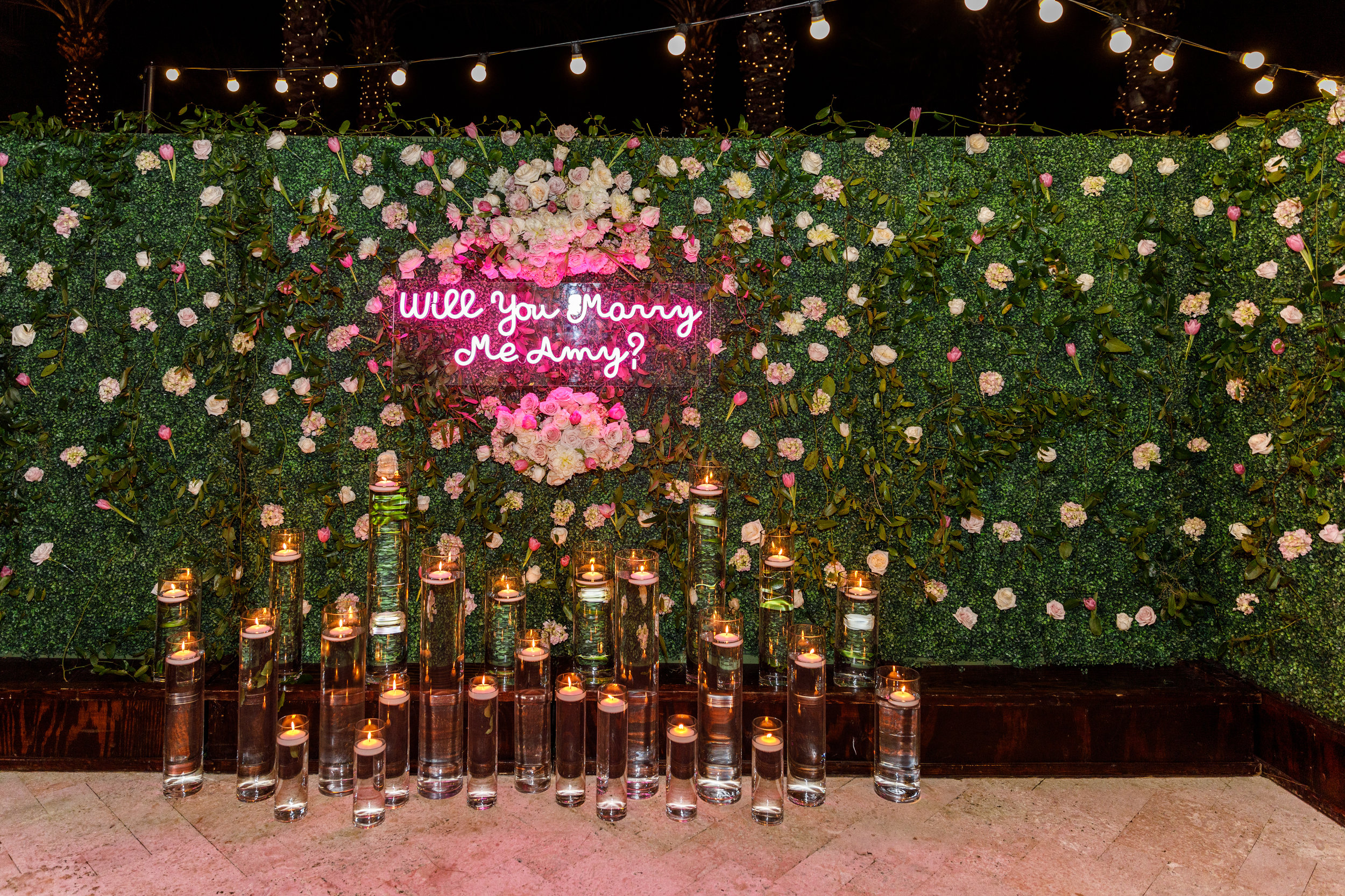 Dream Wedding Proposal planned by Whitney Carillon Events with Neon Sign and pink flowers