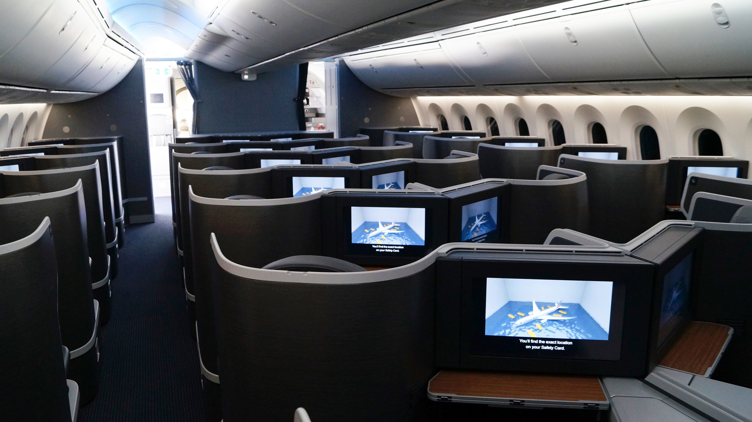 The business class cabin of the Boeing 787-9 as the safety video plays.