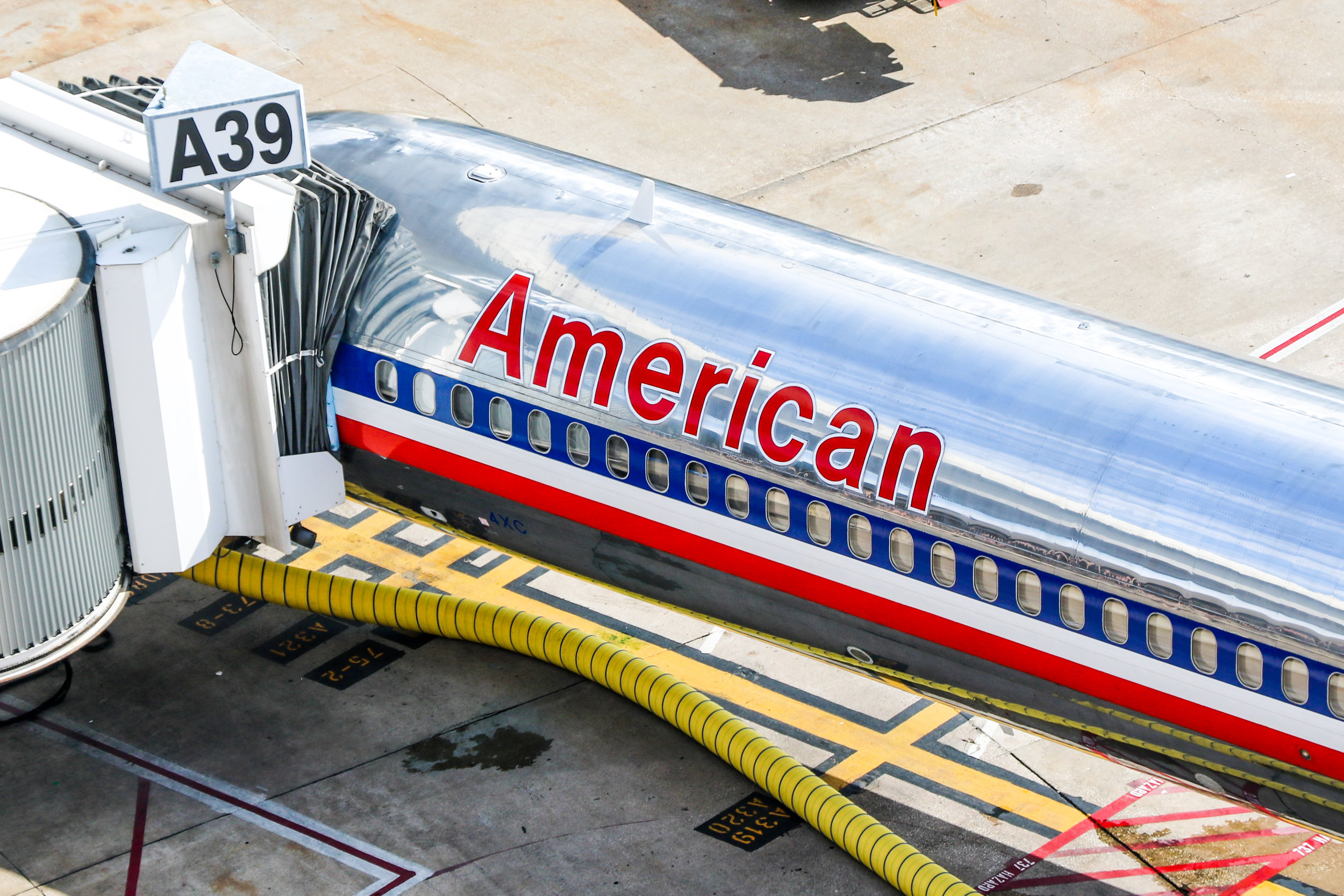 An American MD80 as seen from the company's ramp tower. MD80s are slowly being phased into retirement, being replaced by newer, more fuel efficient Airbus and Boeing aircraft like the 737 and A320 families.