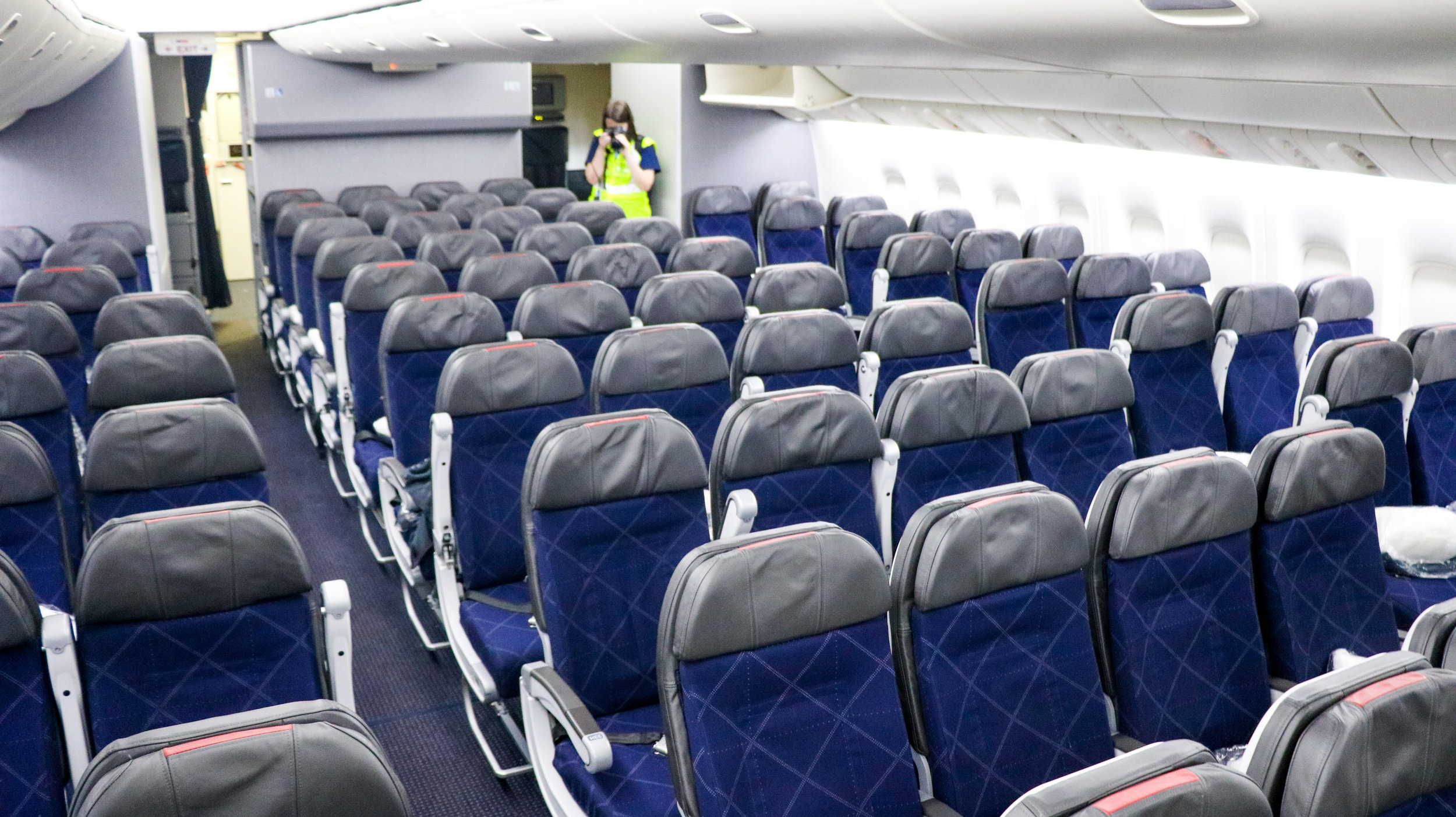 Another aviation photographer takes a picture of economy class on an American Boeing 777-300ER. The ten-abreast seating is becoming the new norm on airlines everywhere.