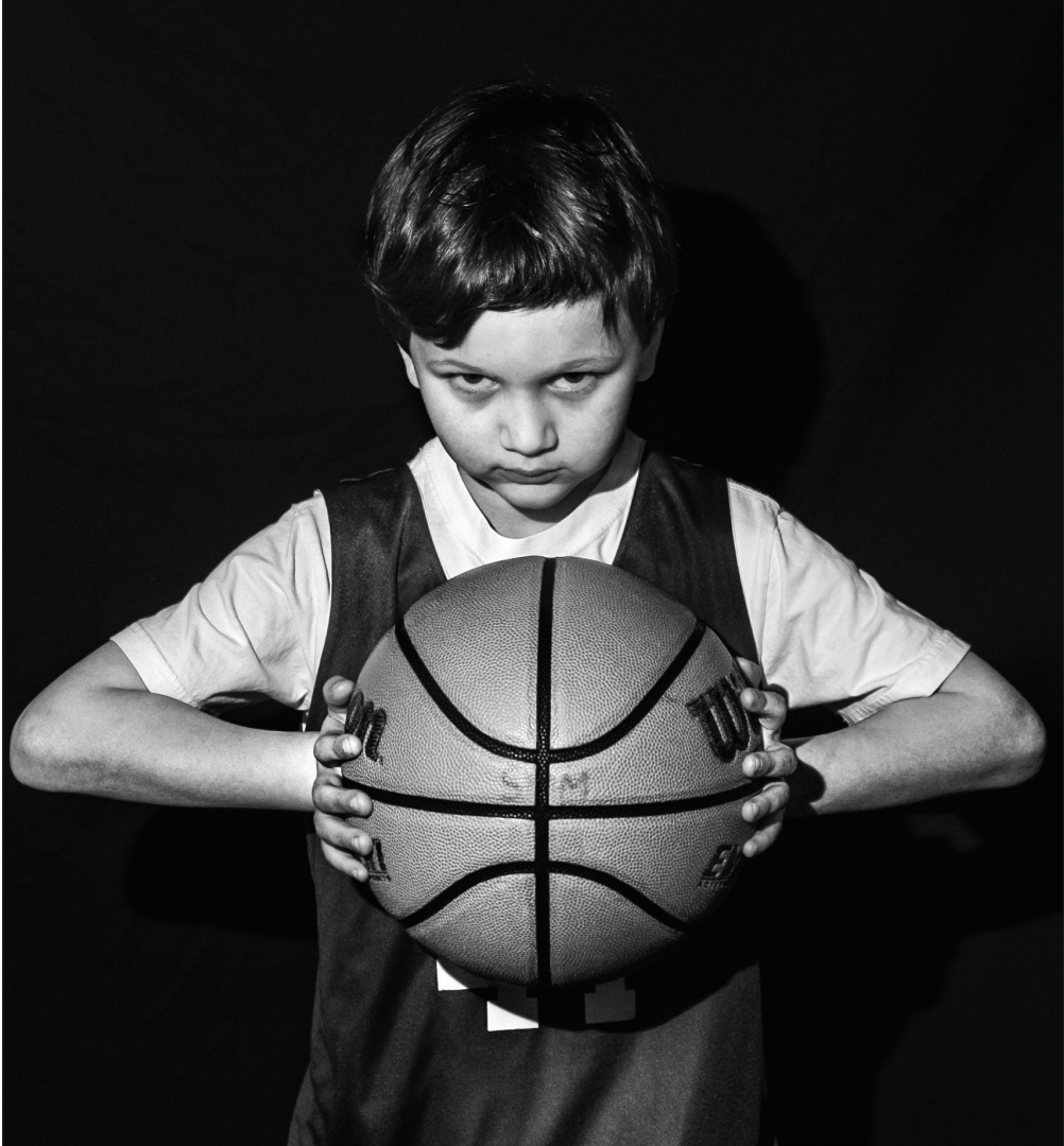 First grader Timmy Strauss stands in the triple threat position, ready to pass, dribble or shoot.