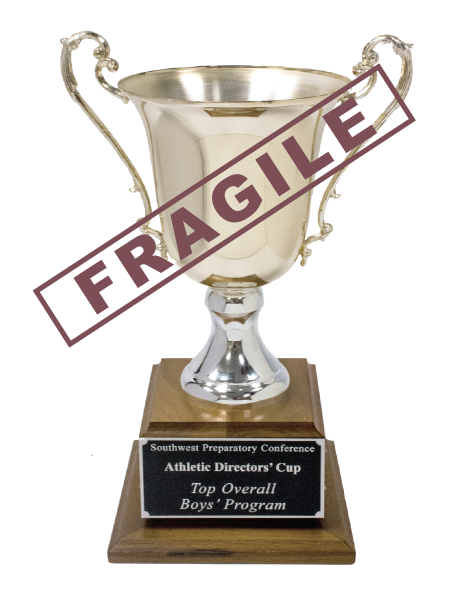 """The Athletic Directors' Cup, which on the three other sides holds plaques detailing every school that had ever won it. Until 2017, it said """"St. Mark's,"""" ten times over."""