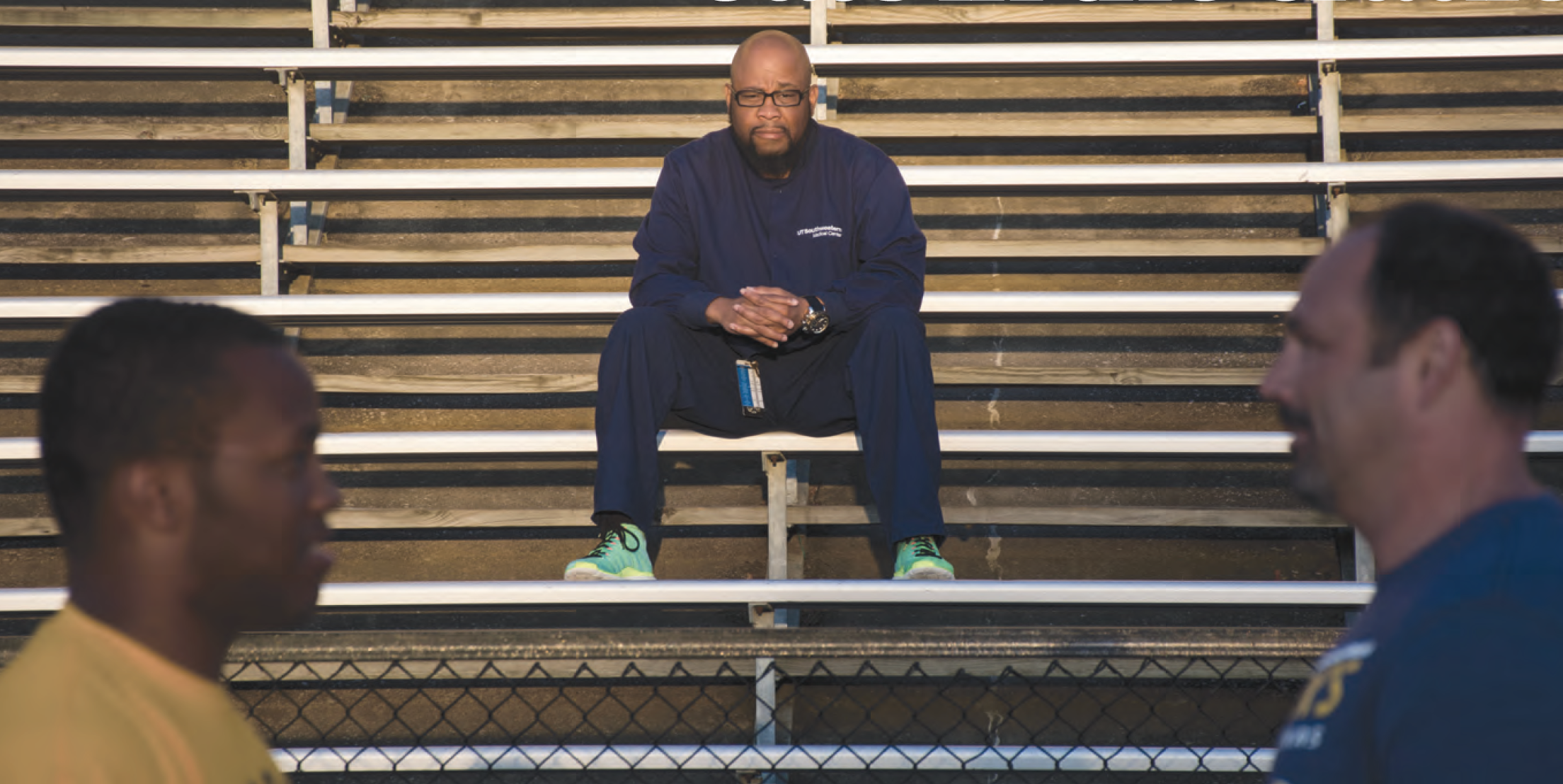 Preston Gilstrap looks on from his spot in the bleachers as head coach Bart Epperson gives his son valuable words of wisdom in life and on the football field.