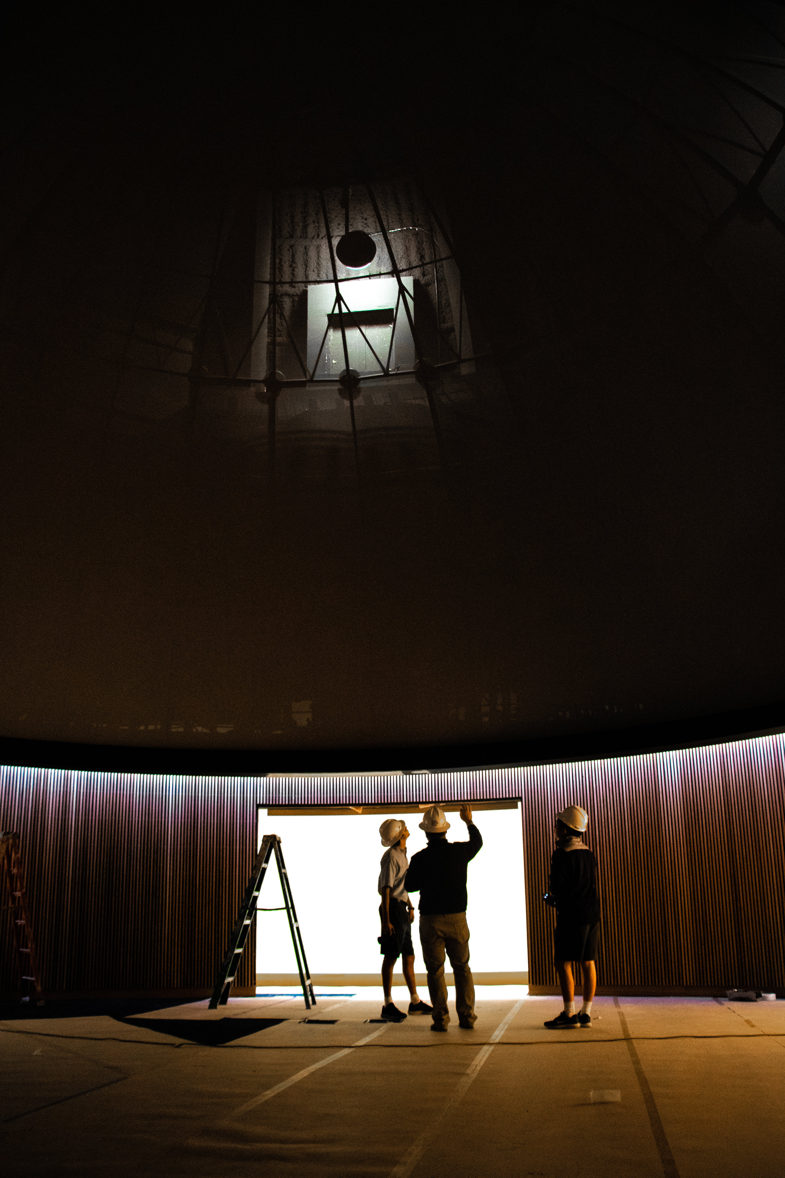 Looking up at the still unfinished dome, Headmaster David Dini points out features of the new planetarium. The planetarium features a new projector and redone seating in order to provide a more viewer-friendly environment when the room is full.