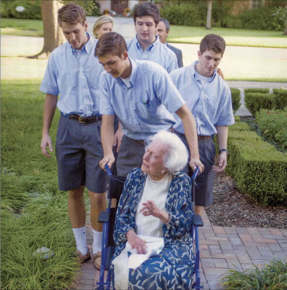 Margaret McDermott is pushed into Headmaster David Dini's house by a group of seniors from the Class of 2015. This photo, which hangs in the Headmaster's office across from his desk, became my inspiration for the opening of the story.