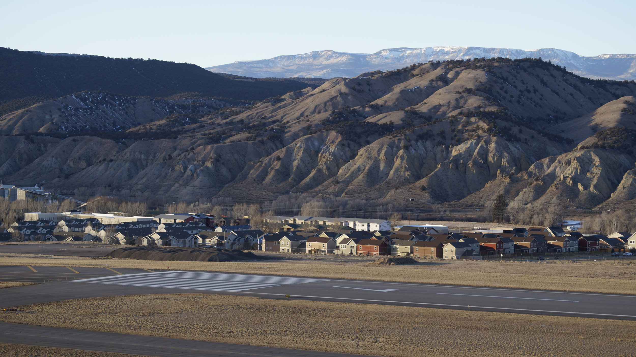 In another one of my ventures into photography from an aerial perspective, I climbed far up above Eagle County Regional Airport in Colorado and took this photo looking past the runway toward the town and mountains that sit behind it.