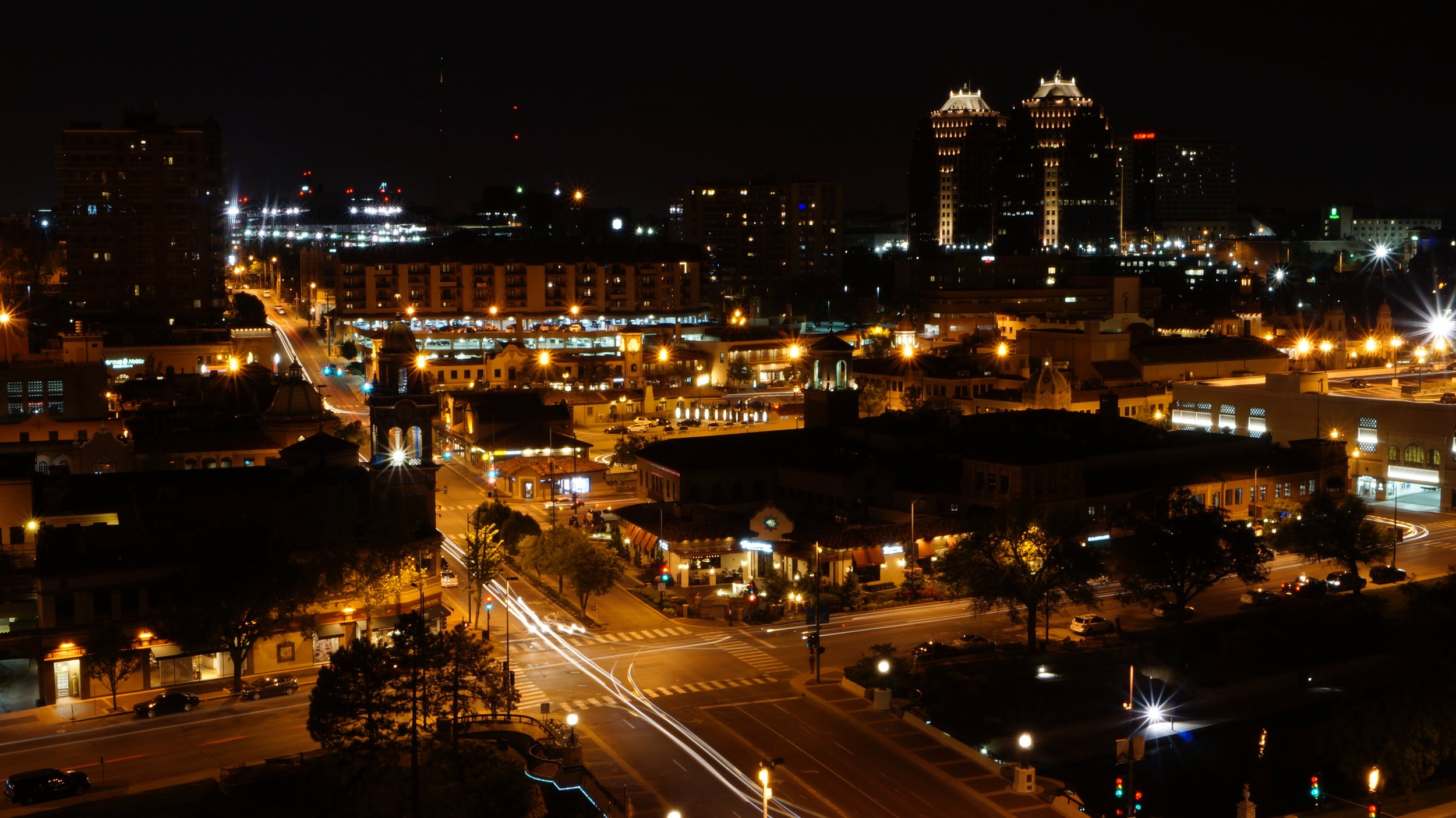 In this image taken overlooking Kansas City's Country Club Plaza, I looked to capture the overall quietness of the nighttime scene, but the intermittent busyness is clear when looking at the light trails and even human silhouettes captured by the long exposure.
