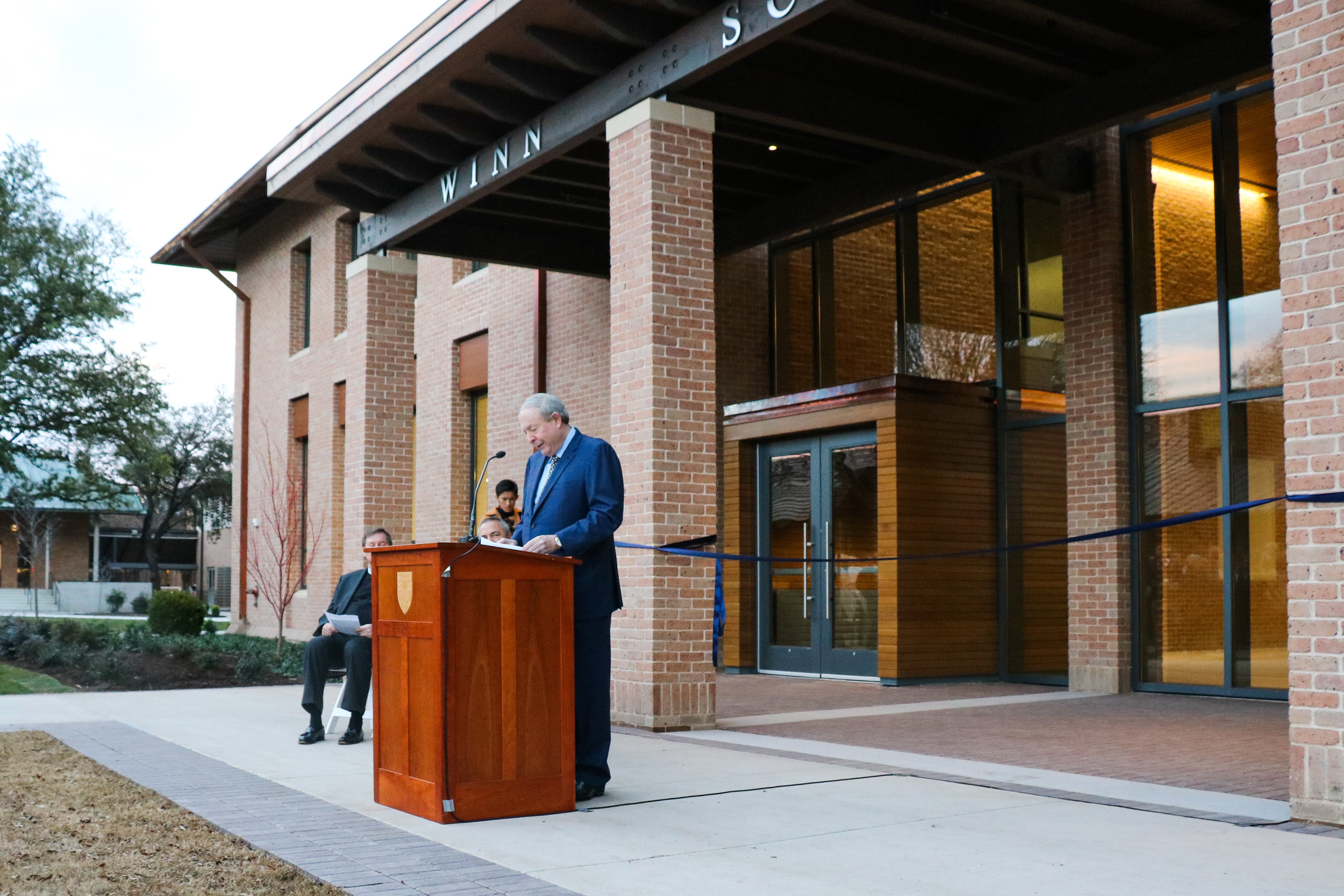 Chuckling as he tells a story of a quirky science teacher, Steve Winn '64 speaks at the opening ceremony of the Winn Science Center Jan. 9. The Winn Family Foundation was the principal donor behind the new building.