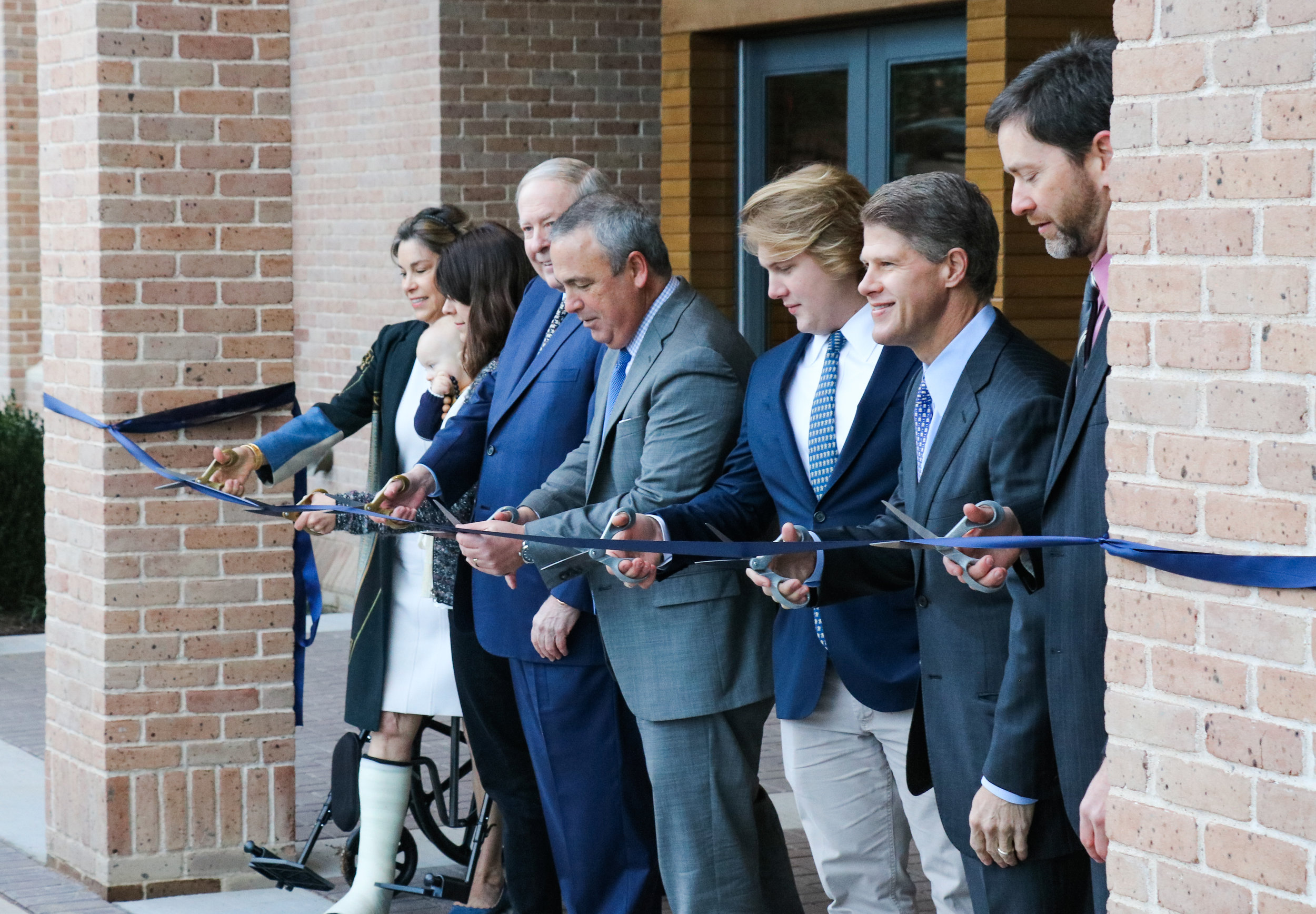 (From left) Steve and Melinda Winn, Headmaster David Dini, Student Council President Landon Wood, President of the Board of Trustees Clark Hunt and Science Department Chair Fletcher Carron cut the ribbon to officially open the Winn Science Center to students and teachers.