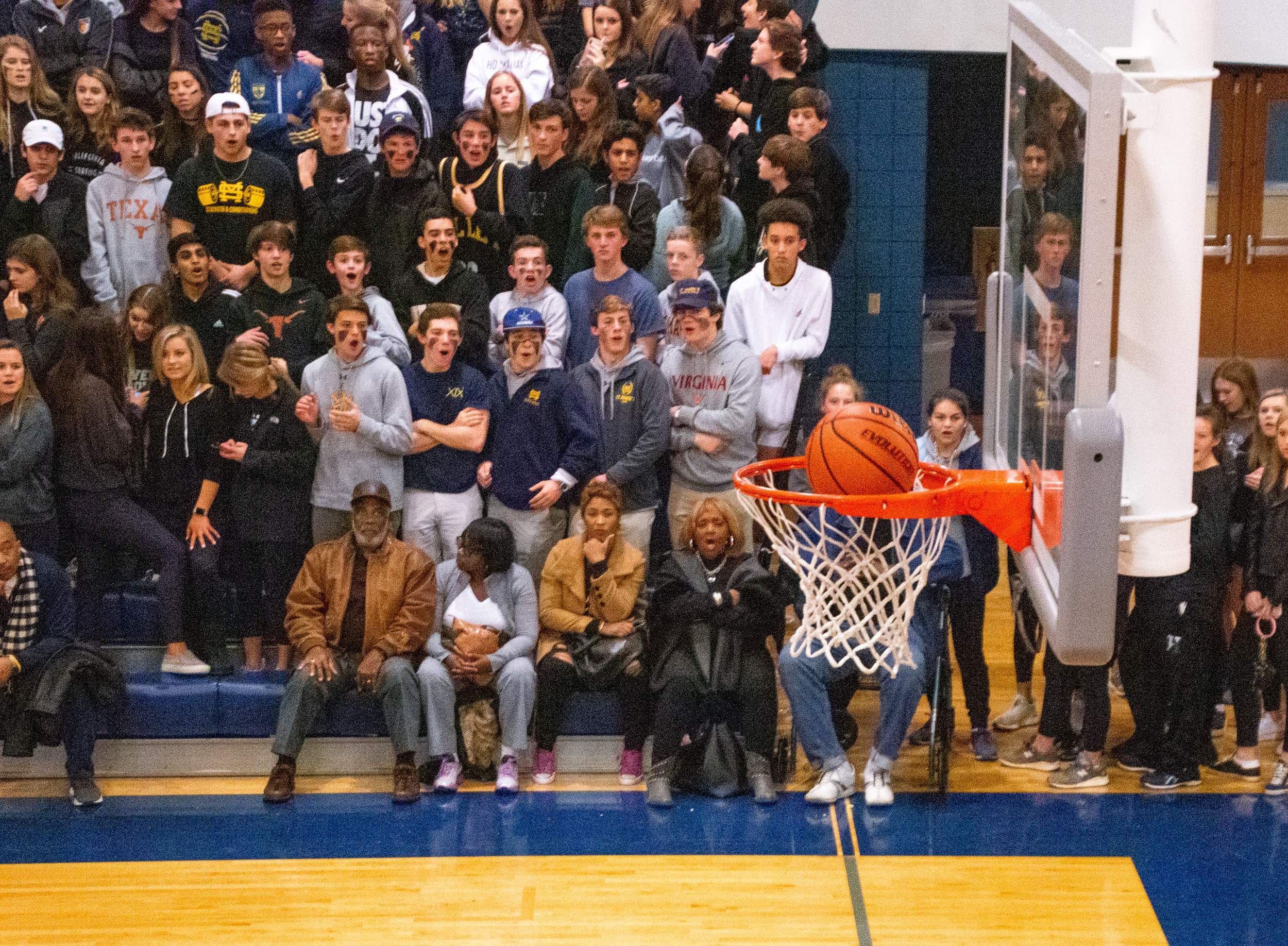 The crowd gasps as a layup by freshman Noah Shelby drops into the hoop. Shelby, beat two ESD defenders in the paint to get to the rim, was fouled on the play, allowing him to grab three points on the play.