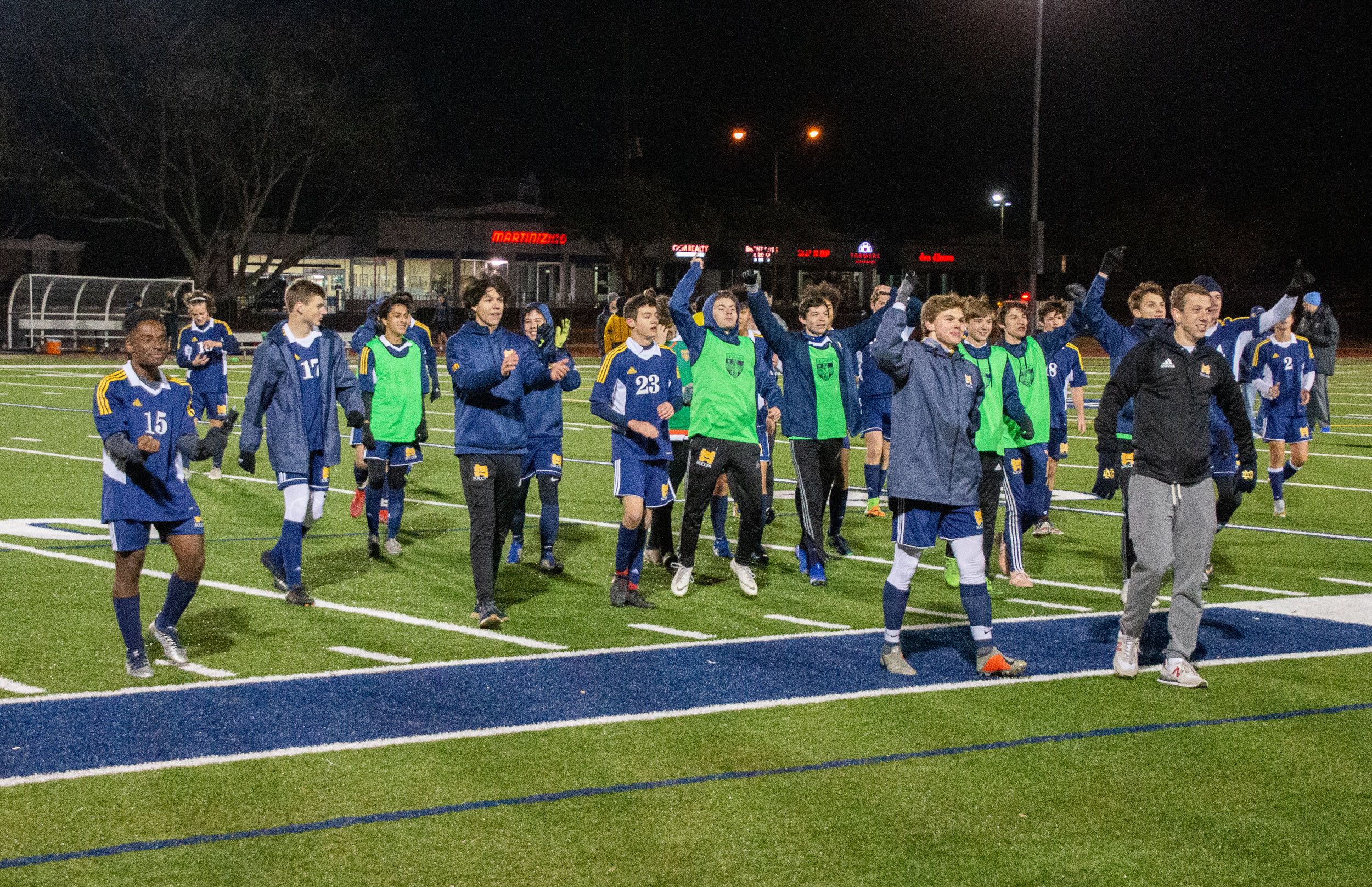 After defeating the Eagles 4-0, the Lions walk up to the screaming student section before singing the Alma Mater to cap off an undefeated night for St. Mark's athletics. By winning the game, the soccer team clinched the first seed heading into the conference tournament Feb. 15-16.