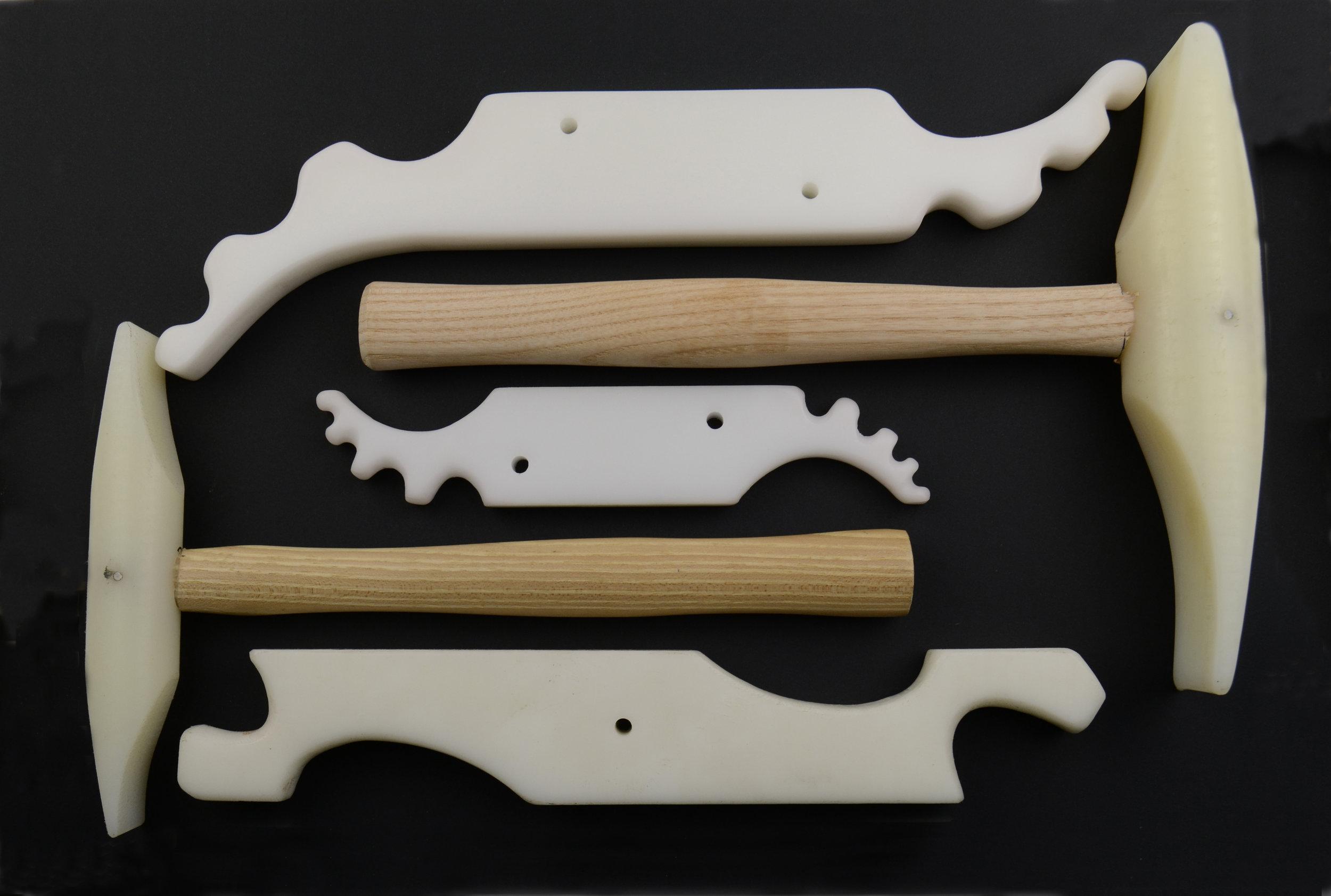 Anticlastic raising tools