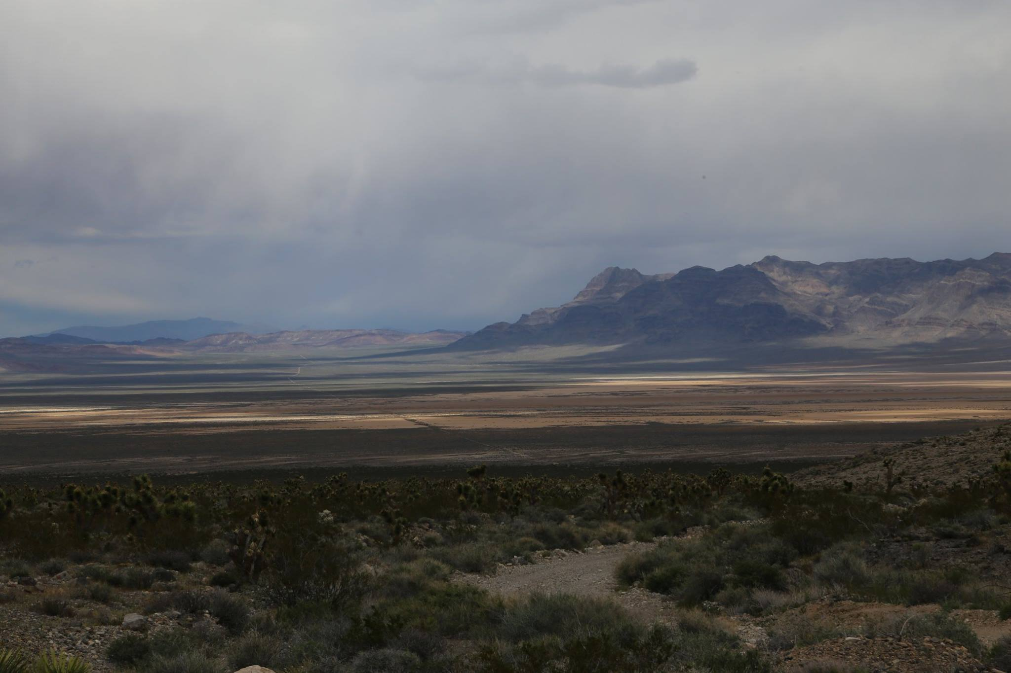 Desert National Wildlife Refuge · April 12, 2017 · Edited ·    View looking north across the dry lake bed.. Alamo Road is a thin ribbon along the valley floor. — at Desert National Wildlife Refuge..jpg