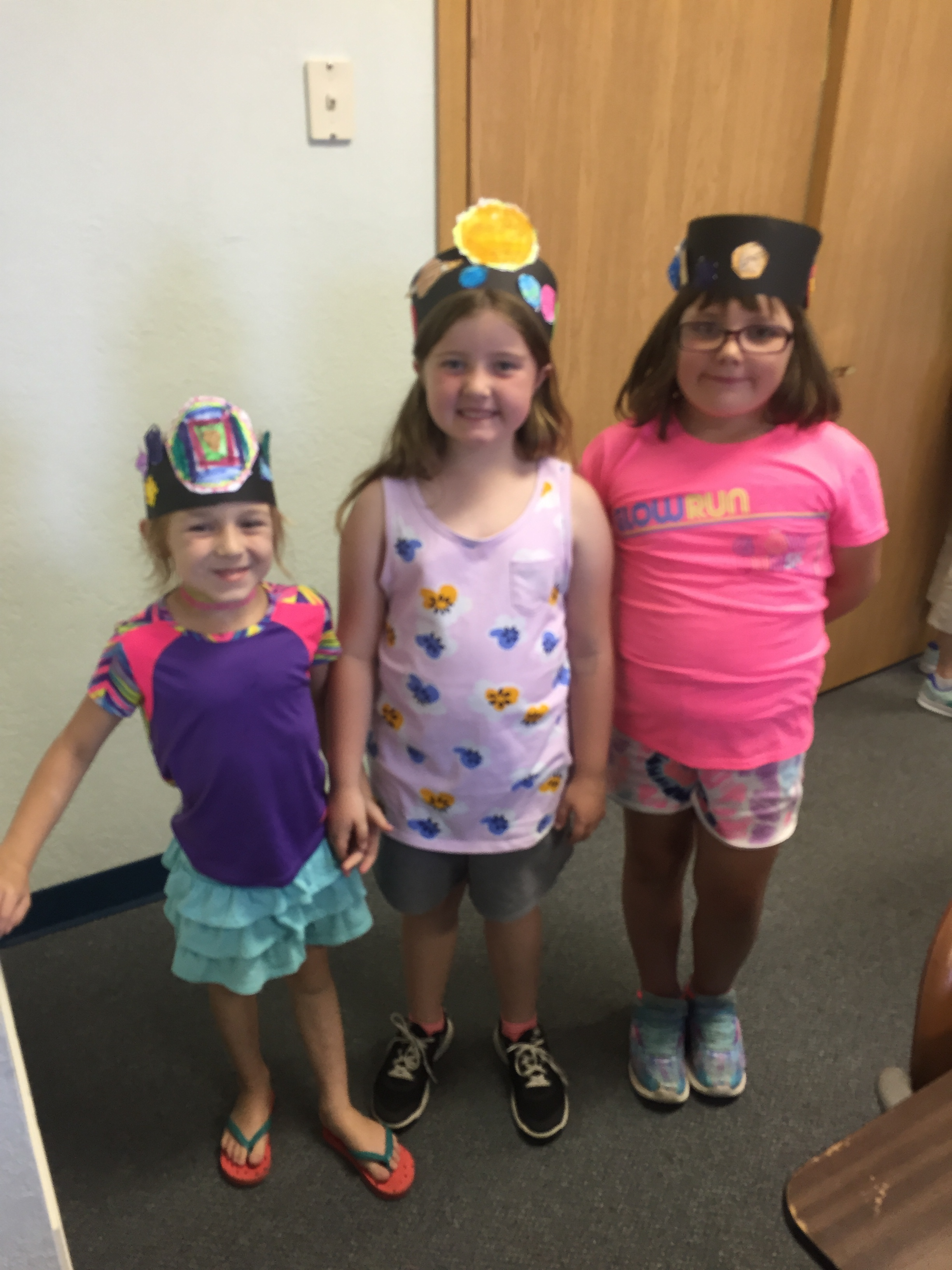 Some first graders rocking their planet hats!