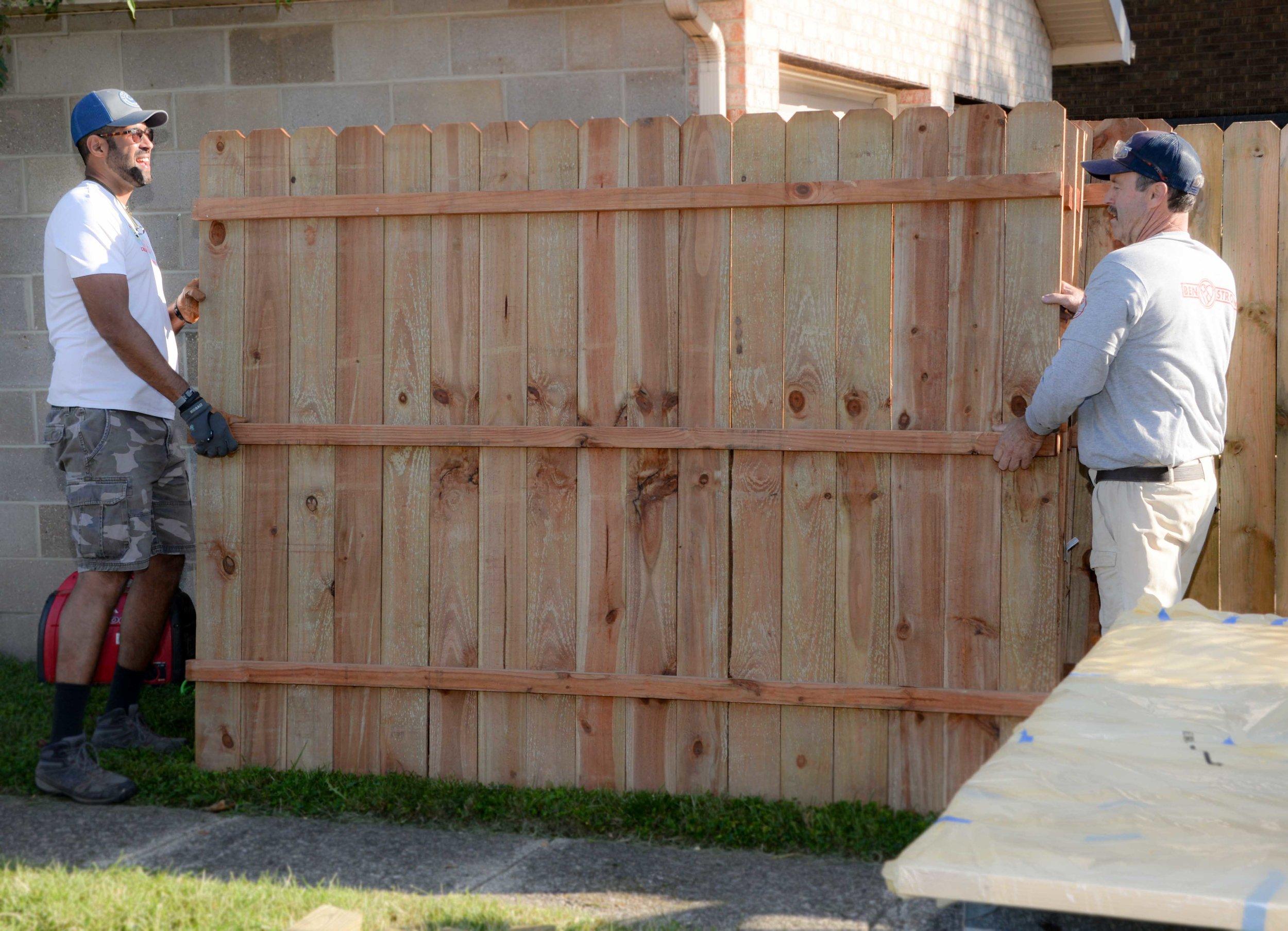 guys-moving-fence.jpg