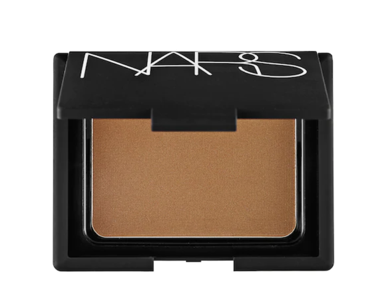 "nars bronzing powder - I use this bronzing powder along my hairline (I make the shape of a number ""3"" as I apply) and on my jawline to contour my face.I use shade ""Laguna"""