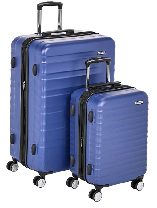 hardcase luggage - Adam bought these and I end up borrowing them a ton. They come with 3 different sizes- I typically use the large one (ha! girl probs). I love the hard shell on them!