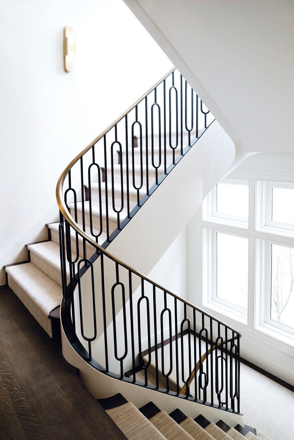 Presidio Heights Bronze railing - Four-story switchback stair with patinated bronze cap rail, Painted steel pickets, cold rolled steel flatbar. Private residence, San Francisco