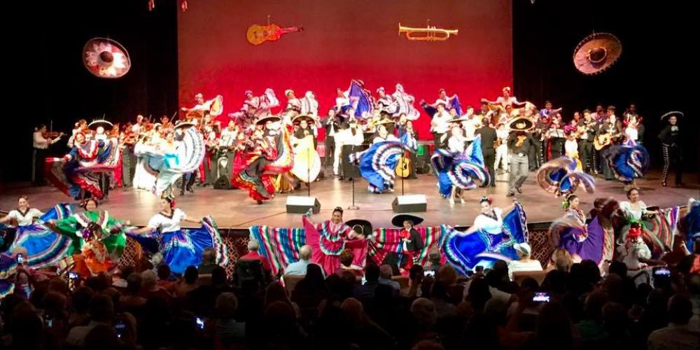 18th_annual_mariachi_concert_-_picture_with_mariachi_students_and_folklorico_dancers.jpg