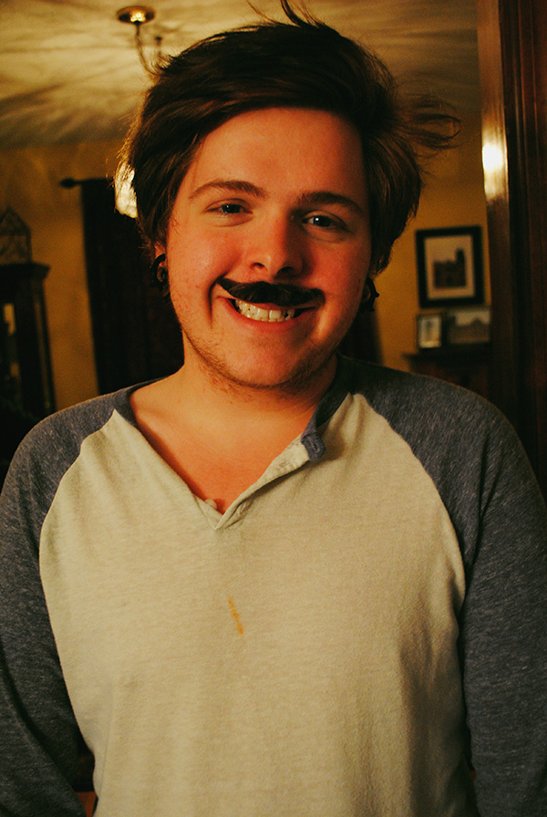 Guest-with-mustache-photo-prop-at-Parks-and-Rec-theme-party-by-Live-the-Movies.jpg