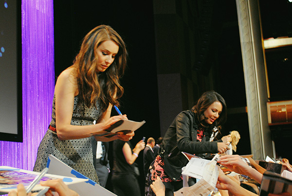 Troian-Bellisario-and-Janel-Parrish-signing-autographs-at-Pretty-Little-Liars-PaleyFest-panel-Live-the-Movies.jpg