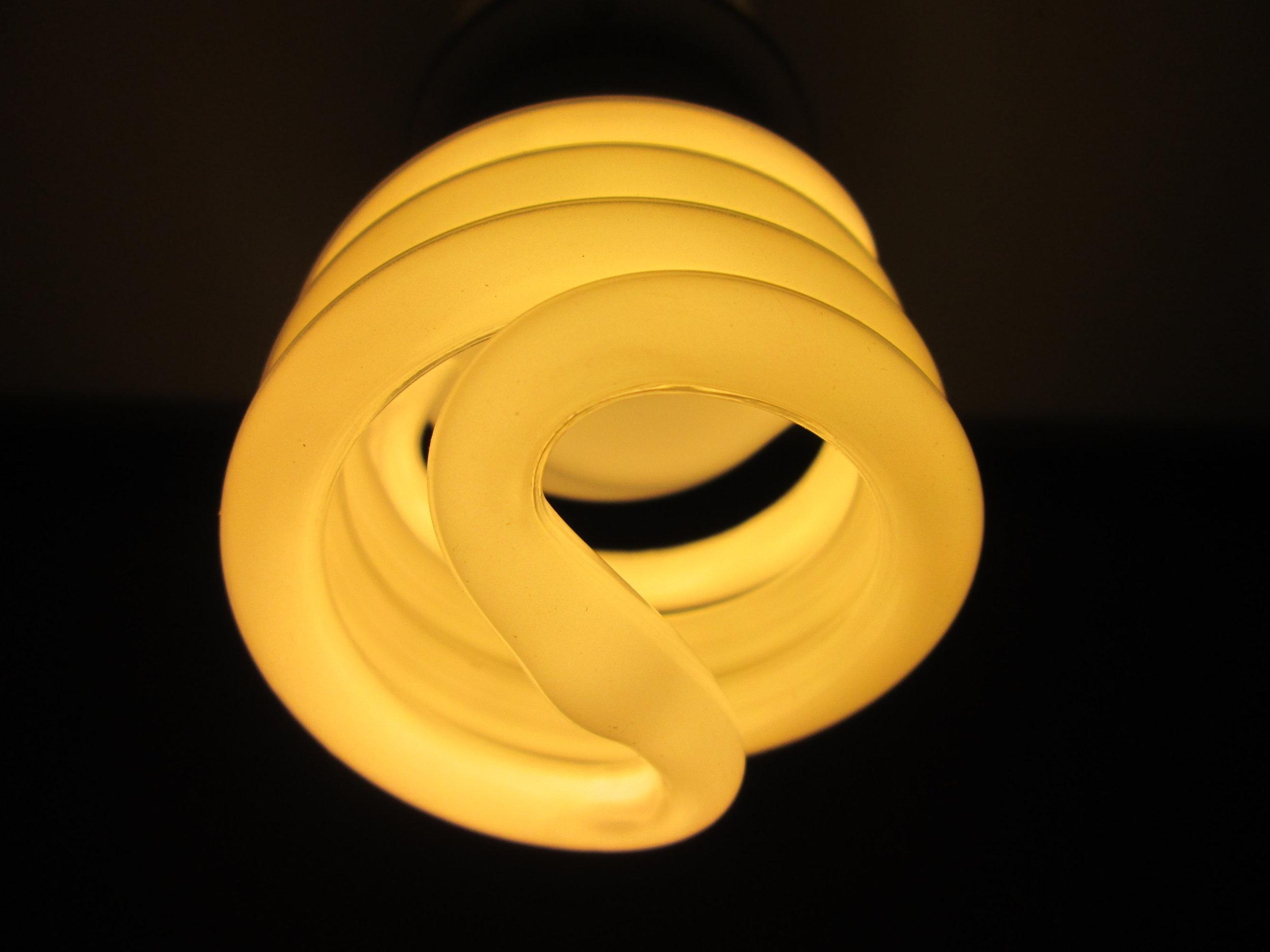 Canva - White Spiral Light Bulb.jpg