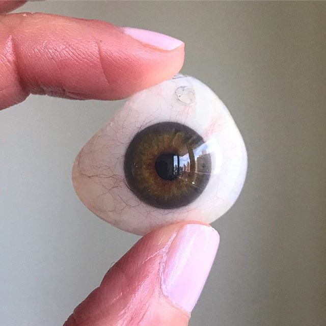 Thanks for eyesplaining this! @eyesplain ・・・ This is a Prosthetic Eye! During my residency I learned how to design and modify prosthetic eye shells. 👁 These are created to fit into an eye socket after an eye has been removed (enucleated) or has lost vision with the prosthetic fitting over the non-seeing eye. 👁 These are made not only to help with improving the overall look of the patient but to keep the eye socket intact. 👁 After removal of an eye, the surrounding tissues tend to contract over time causing the area around the eye to look sunken. Having a prosthetic helps keep the eye socket open and intact. 👁 A patient can keep the prosthetic in full-time, even overnight, and take out only to clean and replace.