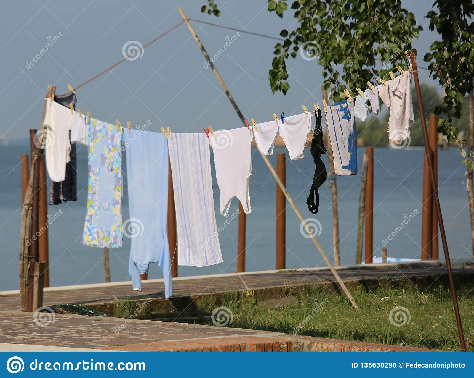 cloths-hung-out-to-dry-outdoors-wet-135630290.jpg