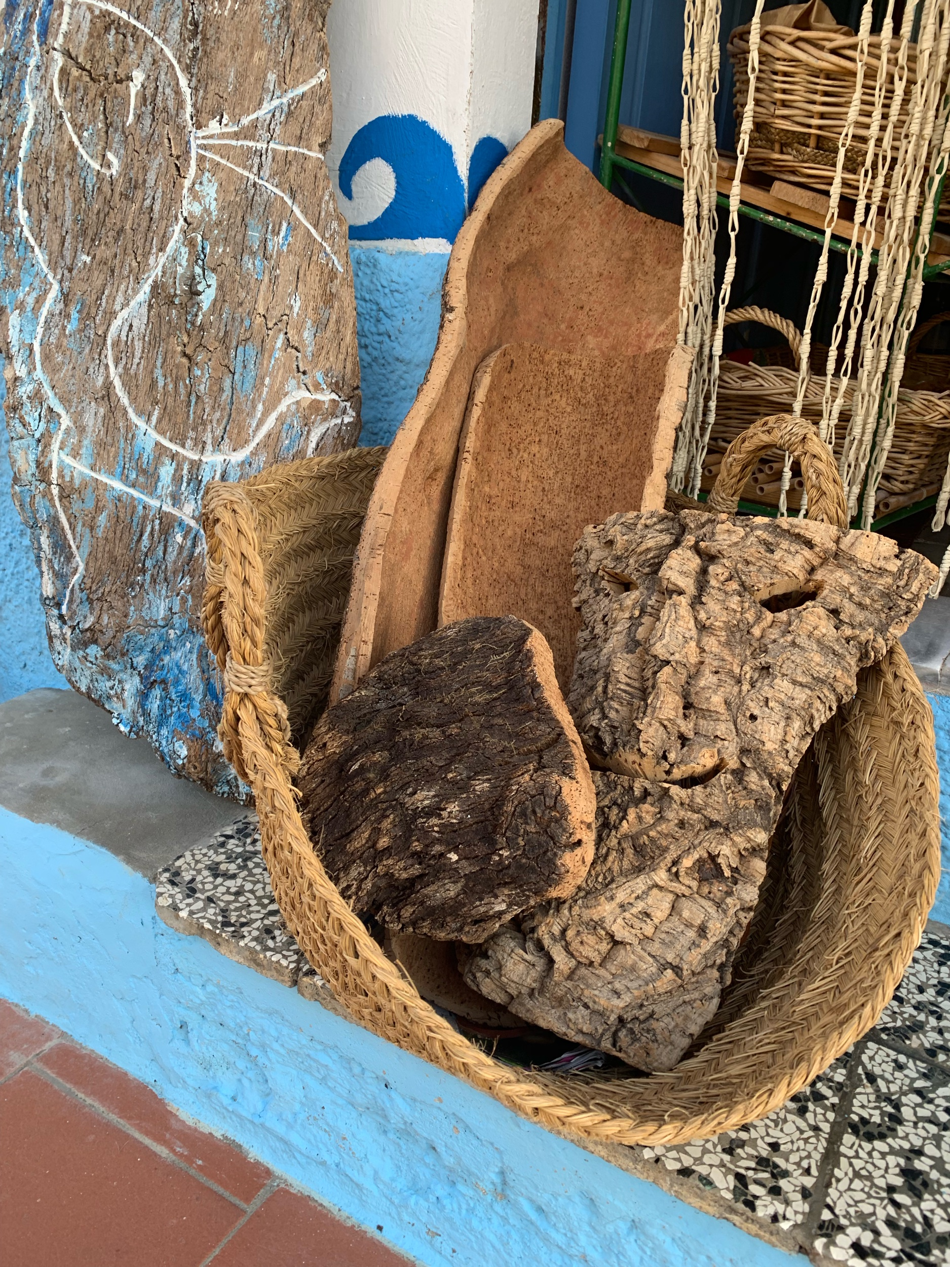A basket of cork tree bark I saw while holiday in Sardinia. Northern Sardinia is the only part of Italy with cork trees.