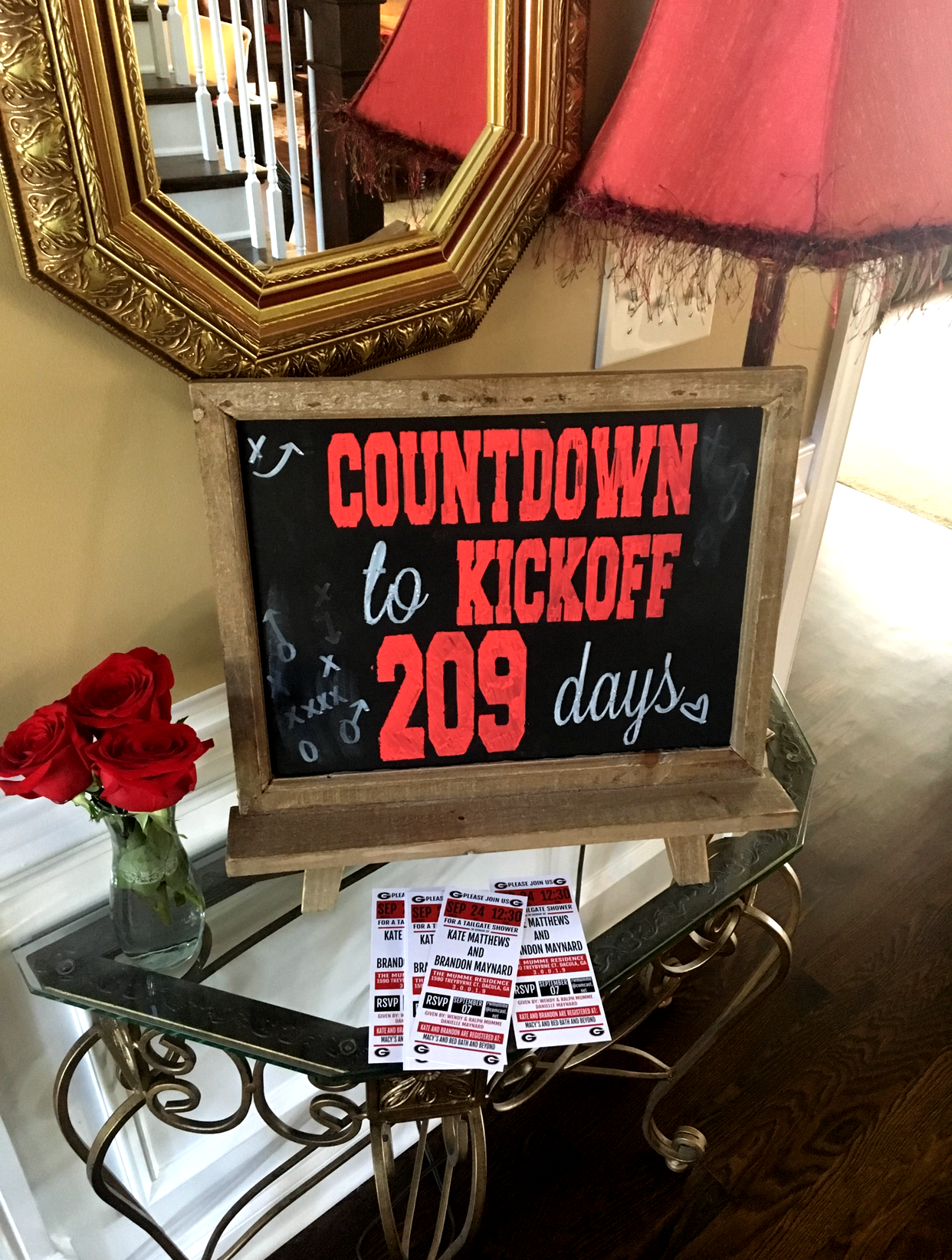 The invites were football tickets & a welcome sign from an old coaches play chalkboard. ;)