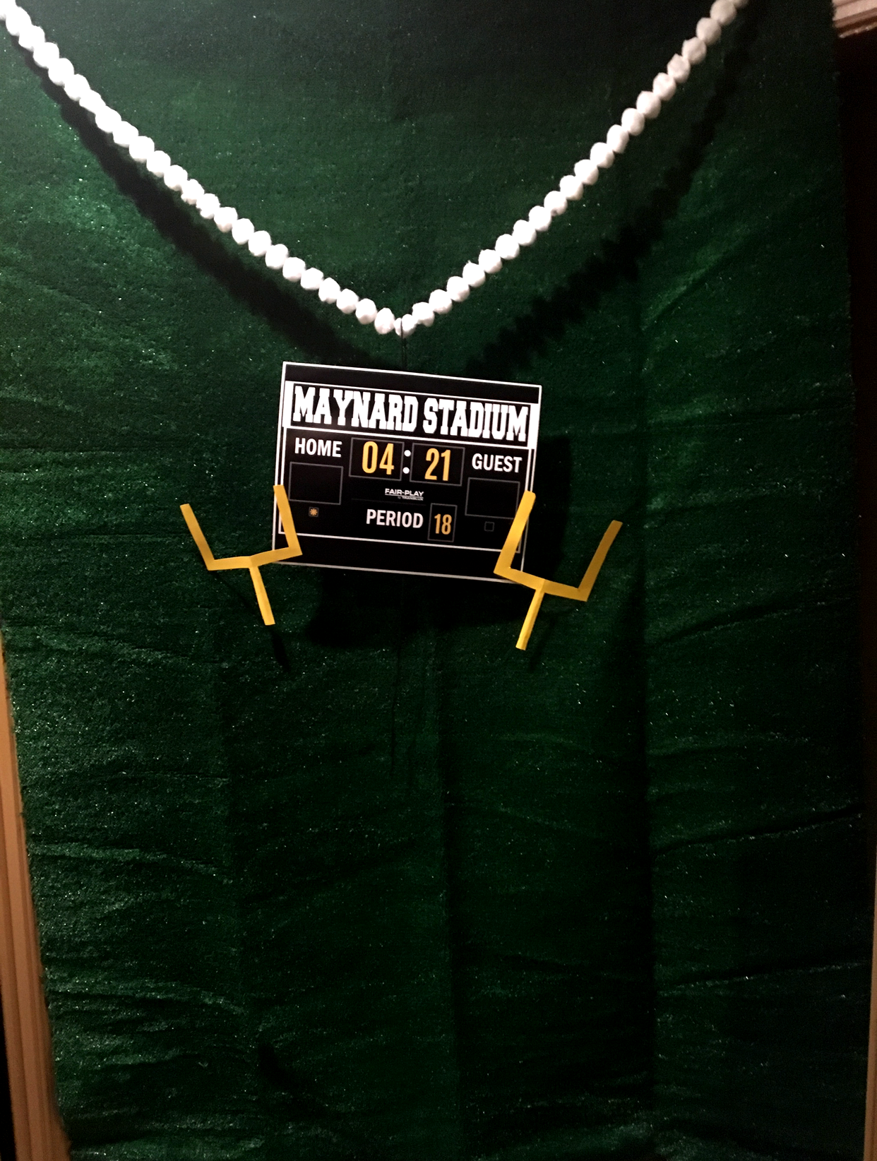 Green turf rug made the perfect backdrop for the photobooth. Homemade scoreboard with added detail with the month//year of the wedding.